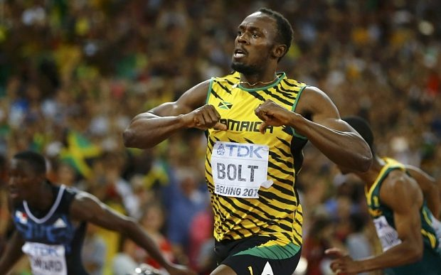 Usain Bolt of Jamaica celebrates winning the men's 200 metres final during the 15th IAAF World Championships at the National Stadium in Beijing, China August 27, 2015. REUTERS/Kai Pfaffenbach